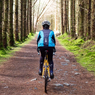 Teenager cycling through forest