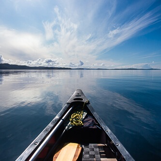 Canoeing on open seas with wide skies